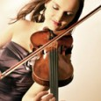 "Polish-born and New York City-based violinist Kinga Augustyn has been described as ""an adventurous performer valuable to New York's scene"" (NY Concert Review), ""a violinist for whom nothing seems too difficult"" (Nowy Dziennik), and ""stylish and vibrant"" (The Strad Magazine)."